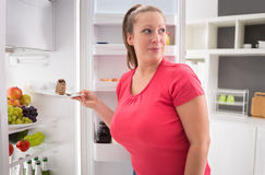Female steal piece of chocolate cake Stock Image