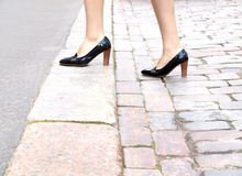 Female stepping onto the sidewalk Royalty Free Stock Image
