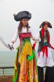 Female stiltwalker in bright Purim pirate costume Stock Photos