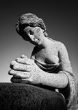 Female Stone Statue Bust. Stone statue of a woman praying in black and white, part of a gravestone Stock Photography