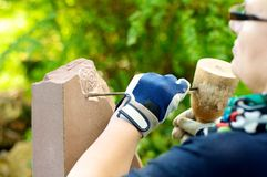 Female stonemason at work. Sandstone is processed by a stonemason Stock Photography