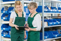 Female storage workers Royalty Free Stock Image