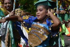 Female Street dancer in colorful coconut costumes join festivity. SAN PABLO CITY, LAGUNA, PHILIPPINES - JANUARY 13, 2017: Female Street dancer in colorful Royalty Free Stock Image