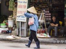 Female street vendor selling fresh fish. Stock Photos