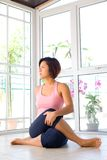 Female stretching the back of thigh muscle Royalty Free Stock Photos