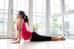 Female stretching her back to strengthen Stock Photo