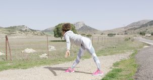 Female stretching during workout on nature stock footage
