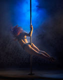 Female striptease on the pole Stock Images
