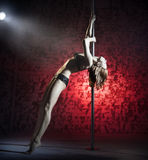 Female striptease on the pole Royalty Free Stock Images