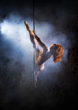 Female striptease on the pole Royalty Free Stock Image