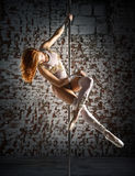Female striptease on the pole Stock Photography