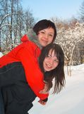 Female struggle. Girls astride the friend on the friend Stock Photos