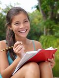 Female student. Student. Asian female university student studying outside in campus park. Beautiful mixed race caucasian / chinese young woman model Stock Photos