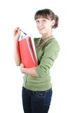 Female student. A smiling female student holding a book isolated on white background royalty free stock photography