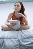 Female student. Going through her lessons notes in her room Royalty Free Stock Photos