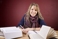 Female Student. Pretty, young woman studying in a home environment Stock Photography