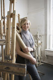 Female Student Amid Easels In Art College Stock Photography