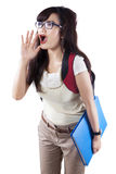 Female student announcing news Royalty Free Stock Photos