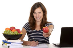 Female student with apple smiling Stock Image