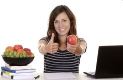 Female student with apple smiling Royalty Free Stock Photos
