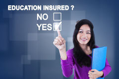 Female student approving with education insured Stock Photos