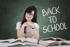 Female student back to school and smiling Royalty Free Stock Photography