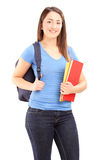 Female student with backpack holding notebooks Royalty Free Stock Images