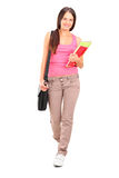 Female student with bag and books walking Royalty Free Stock Photo