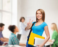Female student with bag, tablet pc and folders Stock Photo