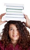 Female student balancing books Royalty Free Stock Image