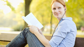 Female Student with a Book in a Park Stock Images