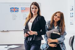 Female student with books in classroom English language school. royalty free stock photos