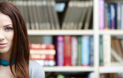 Female student with books. Half face Royalty Free Stock Photography