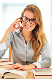 Female student with books in the library Stock Photos