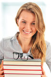 Female student with books in the library Royalty Free Stock Image