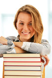 Female student with books in the library Royalty Free Stock Photos