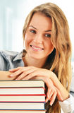 Female student with books in the library Stock Images