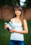 Female student with books outdoors Royalty Free Stock Photography