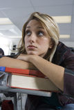 Female Student Bored In Class Stock Images