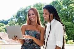 Female student and friend looking at computer royalty free stock image