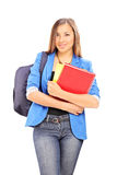 Female student carrying a backpack and notebooks Stock Image
