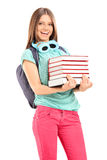 Female student carrying a pile of books Stock Photos