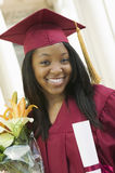Female Student With Certificate And Bouquet On Graduation Day Royalty Free Stock Photography