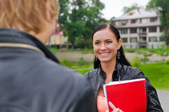 Female student chatting Stock Image