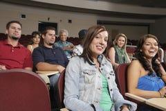 Female Student With Classmates Stock Image