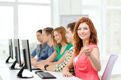 Female student with classmates in computer class Stock Images
