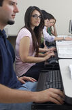 Female Student With Classmates In Computer Lab Stock Photo