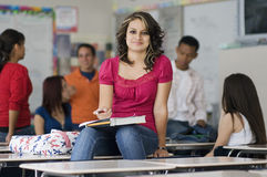 Female Student In Classroom With Friends Royalty Free Stock Photography