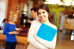 Female student in classroom Stock Images