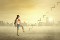 Female student is climbing stair Royalty Free Stock Photography
